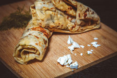 Typical Turkish meal Gozleme with herb and cheese on light woode Royalty Free Stock Photo