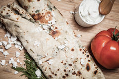 Typical Turkish meal Gozleme with herb and cheese on light woode Stock Photography