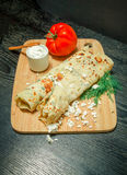 Typical Turkish meal Gozleme with herb and cheese on light woode Royalty Free Stock Images