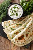 Typical Turkish meal Gozleme with herb and cheese on slate board. On the table. Vertical top view from above stock photography