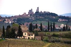 Typical Tuscan landscape. San Gimignano. typical Tuscan landscape - a view of a villa on a hill, a cypress alley and a valley with vineyards, province of Siena Royalty Free Stock Photos