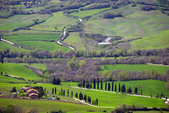 Typical Tuscan landscape. A view of a villa on a hill and green fields at sunny day. province of Siena. Tuscany, Italy Stock Images