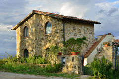 Tuscan house. Typical Tuscan old farmhouse. View on the fasade at sunrise royalty free stock image