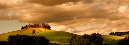 Typical tuscany countryside. Typical tuscan countryside with farm and meadow Stock Photo