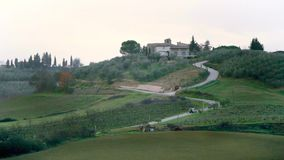 Typical Tuscany landscape with car traveling on the road in the green hills.  stock footage