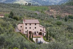 Typical Tuscany landscape with hills, green trees and mansion, Italy. The view of typical Tuscany landscape with hills, green trees and mansion stock photos