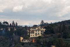 Typical Tuscany landscape with typical houses on a hill, Italy royalty free stock image