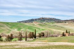 Typical Tuscany landscape in Val d`Orcia. In the background the medieval village of Pienza.  royalty free stock photography