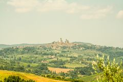 Typical Tuscany landscape with village. And clouds royalty free stock image