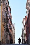 Typical urban canyon in Lisbon, Portugal Royalty Free Stock Image