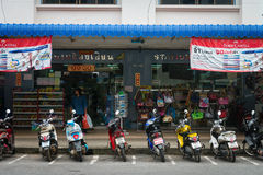 Typical urban storefronts in Krabi, Thailand, with motorcycles Stock Image