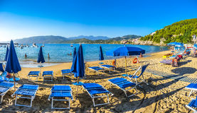 Typical vacation beach with beachchairs and sunshades at sunset Royalty Free Stock Photo