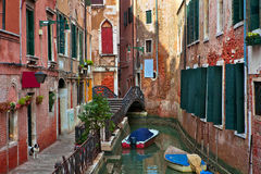 Typical venetian canal among old building. Stock Photography