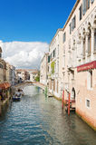 Typical Venetian canal on a sunny day Royalty Free Stock Image