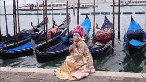 A Typical Venetian Mask with gondolas and Venice Lagoon on the background, Venice. Italy stock video