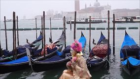 A Typical Venetian Mask with gondolas, Venice Lagoon, Italy. A Typical Venetian Mask with gondolas and Venice Lagoon on the background, Venice, Italy stock footage