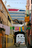 Typical Venice calle with passenger ship in the background Royalty Free Stock Photo