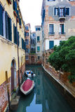 Typical Venice canal with moored boats Stock Photos