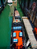 Typical Venice Canal with View of Gondola from Overhead Stock Images
