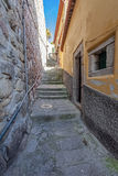 The typical very narrow and steep medieval street of the older parts of the city Royalty Free Stock Photo