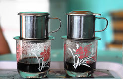 Typical Vietnam Coffee. Two Glasses of Typical Vietnam Coffee on a Table Stock Images