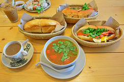 Typical Vietnamese Feast. A selection of typical Vietnamese cuisine being served on table such as Fresh Spring Rolls, Banh mi and coffee stock image