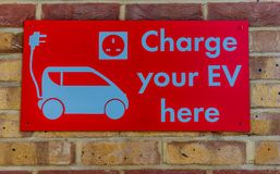A typical view in Belgravia in London. London. August 2018. A view of an electric vehicle charging sign in London royalty free stock photo