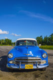 Typical view of classic blue American car on Cuba near Havana. Typical view of classic blue American car on Cuba where old vehicles become iconic part of Cuba Royalty Free Stock Images