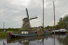 The typical view of Dutch canal Stock Photos