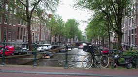 Typical view over the bridges and canals in the canal belt of Amsterdam. Amsterdam - Holland stock footage