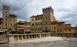Typical view of Piazza Grande in Arezzo old town. Typical view of Piazza Grande ancient square in Arezzo old town with its ancient buildings an tower stock images