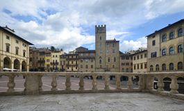 Typical view of Piazza Grande in Arezzo old town. Typical view of Piazza Grande ancient square in Arezzo old town with its ancient buildings an tower stock photography