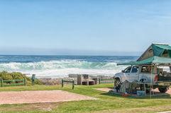 Typical view at the rest camp at Storms River Mouth. STORMS RIVER MOUTH, SOUTH AFRICA - FEBRUARY 29, 2016:  A pick-up truck with roof ten and a sea view in a Royalty Free Stock Photos