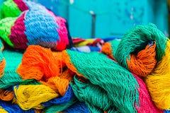 A typical view in San Salvador, El Salvador. San salvador, El salvador. January 2018. Colourful fishing nets for sale in a market in San Salvador, El Salvador Royalty Free Stock Image