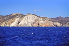 Typical view of sea and cliffs in the Cyclades. Greece building hora city frame sky picturesque vacation seascape europe mediterranean town landscape royalty free stock images
