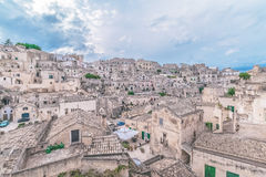 Typical view of stones (Sassi di Matera) of Matera under blue sky. Matera in Italy. UNESCO European Capital of Culture 2019 royalty free stock image