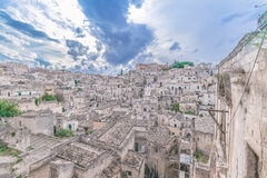 Typical view of stones (Sassi di Matera)  of Matera under blue sky. Matera in Italy Royalty Free Stock Photos