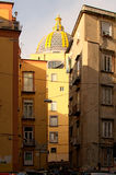Typical view of street in Naples. Behind several apartment buildings one can see a beautiful dome of the cathedral.  Royalty Free Stock Photos