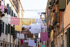 Typical view; the streets of Venice; washed clothes drying on cords outside the building, Venice, Italy Royalty Free Stock Image