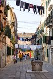 Typical view of the streets of Venice; washed clothes drying on cords outside the building, Venice, Italy Royalty Free Stock Images