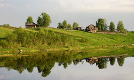 A typical village on a river in Nothern Russia. Royalty Free Stock Photos