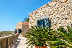 Typical wall for old Greek buildings with palm trees in foregrou. Nd, Greece Stock Images