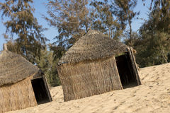 Typical West-African huts with a straw roof Stock Photos