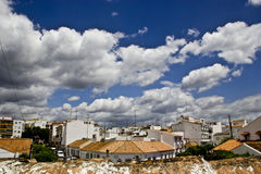 Typical white andalusian village. In malaga with cloudly sky Stock Image