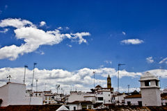 Typical white andalusian village. In malaga with cloudly sky Royalty Free Stock Photo