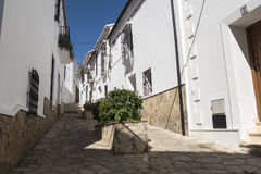 Typical white Andalusian village street in Benaocaz, Cadiz provi. Typical white Andalusian village street in Benaocaz, Cadiz, Spain Royalty Free Stock Photography