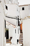 Typical white andalusian village. Typical street in white andalusian village in malaga Royalty Free Stock Image