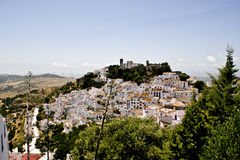 Typical white andalusian village. Typical street in white andalusian village in malaga Royalty Free Stock Photo