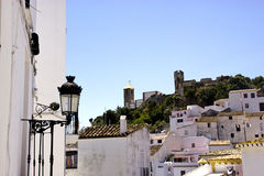 Typical white andalusian village. Typical street in white andalusian village in malaga Stock Image