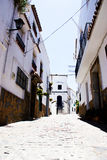 Typical white andalusian village. Typical street in white andalusian village in malaga Stock Images